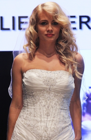 strapless: ZAGREB, CROATIA - OCTOBER 27: Fashion model wears wedding dress made by In Atelier Hera on Wedding days show, October 27, 2012 in Zagreb, Croatia.