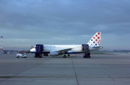 ZAGREB, CROATIA - NOVEMBER 04: Croatia Aerlines A319 serviced by the ground crew on November 04, 2012 in Zagreb, Croatia. Croatia Airlines is a Star Alliance member and the leading airline (in terms of passengers) from the former Yugoslavia. Stock Photo - 17069921
