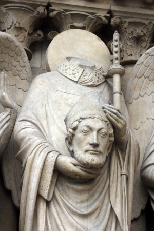 Saint Denis holding his head, Notre Dame Cathedral, Paris, Portal of the Virgin photo