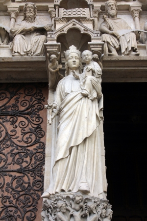 Madonna with Child, Notre Dame Cathedral, Paris, Portal of the Virgin photo