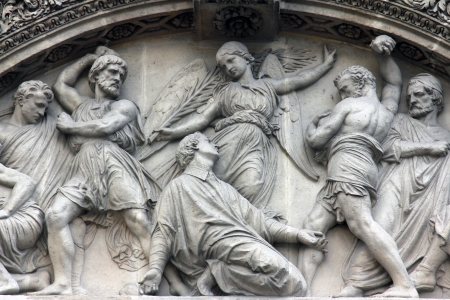 martyr: The Martyrdom of St. Stephen pediment of the front door of the Saint Etienne du Mont Church, Paris.
