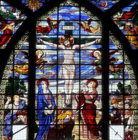 believing: Crucifixion, Jesus on the cross, stained glass window from Saint-Jean de Montmartre church, Paris Editorial