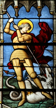 slaying: Saint George slaying the dragon, Saint Severin church, Paris, France Editorial
