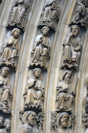 Paris, Notre-Dame cathedral, portal of the Virgin, the archivolts are populated by the Heavenly Court (angels, patriarchs, kings, and prophets). photo