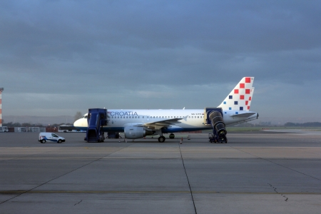 former yugoslavia: ZAGREB, CROATIA - NOVEMBER 04: Croatia Aerlines A319 serviced by the ground crew on November 04, 2012 in Zagreb, Croatia. Croatia Airlines is a Star Alliance member and the leading airline (in terms of passengers) from the former Yugoslavia.