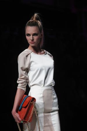 wears: ZAGREB, CROATIA - MARCH 13  Fashion model wears clothes made by Aleksandra Dojcinovic on  PERWOLL FASHION HR  show on March 13, 2013 in Zagreb, Croatia