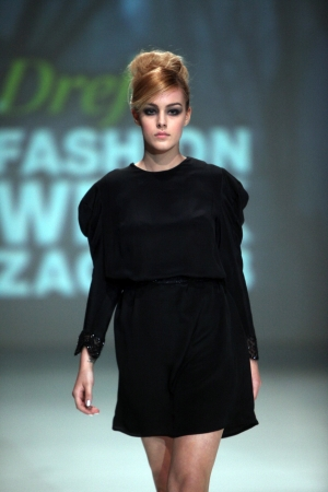 wears: ZAGREB, CROATIA - May 11  Fashion model wears clothes made by Ivancica Hrustic on  ZAGREB FASHION WEEK  show on May 11, 2013 in Zagreb, Croatia