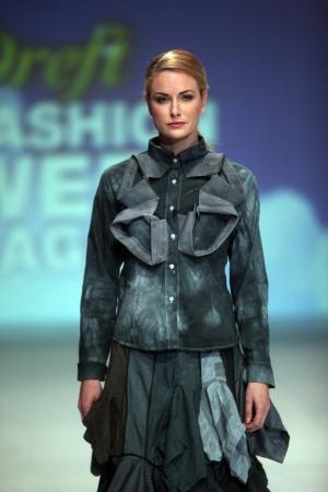 wears: ZAGREB, CROATIA - May 11  Fashion model wears clothes made by Ana Kujundzic on  ZAGREB FASHION WEEK  show on May 11, 2013 in Zagreb, Croatia