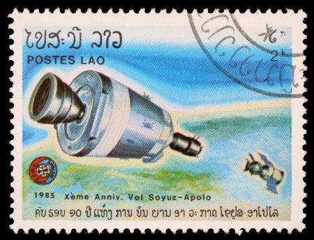 LAOS- CIRCA 1985: A stamp printed in Laos shows experimental flight of Soyuz and Apollo, circa 1985