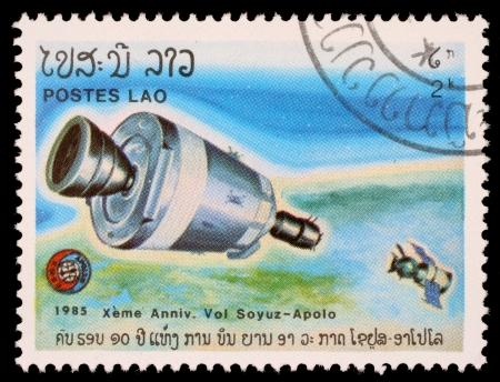 soyuz: LAOS- CIRCA 1985: A stamp printed in Laos shows experimental flight of Soyuz and Apollo, circa 1985