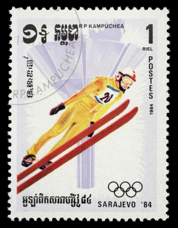 olympic symbol: CAMBODIA - CIRCA 1984: A canceled stamp printed in Cambodia shows image of ski jumper on occasion of the Olympic games in Sarajevo circa 1984. Editorial