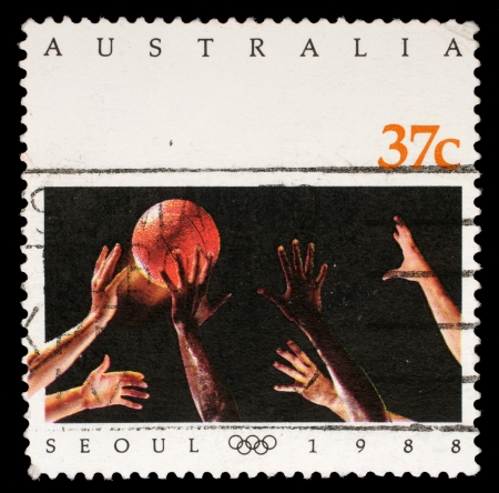 olympic symbol: AUSTRALIA - CIRCA 1988: A stamp printed in Australia shows Basketball on the Olympic games in Seoul, circa 1988
