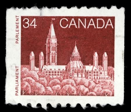 canada stamp: CANADA - CIRCA 1985: A stamp printed in Canada shows a Parliament (Library) in Ottawa, Ontario, series, circa 1985