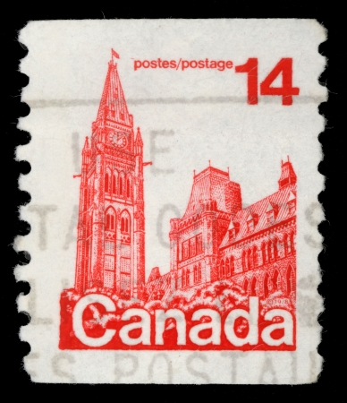 canada stamp: CANADA - CIRCA 1977: A stamp printed in Canada shows Parliament Buildings, circa 1977
