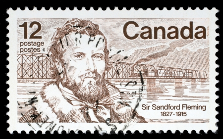 canada stamp: CANADA - CIRCA 1977: A stamp printed in Canada shows Sir Sandford Fleming, a Canadian engineer who designed Canada Editorial