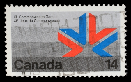 canada stamp: CANADA - CIRCA 1978: A stamp printed in Canada shows a symbol of XI Commonwealth Games with the same inscriptions and name of series, circa 1978