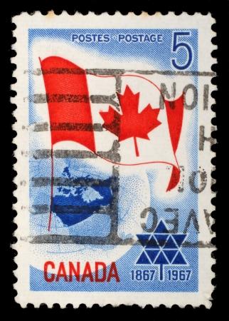 canada stamp: CANADA - CIRCA 1967: A stamp printed in Canada shows Canada flag, circa 1967 Editorial