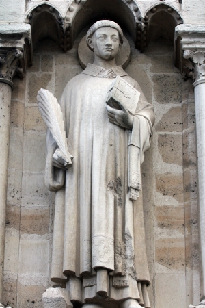 Statue of Saint Stephen, Notre Dame Cathedral, Paris photo