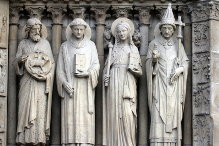 Paris, Notre-Dame cathedral, portal of the Virgin, from left to right  Saint John the Baptist, Saint Stephen, Saint Genevieve and Pope Saint Sylvester