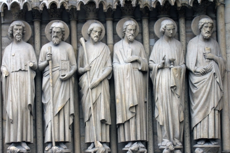 sain: Paris, Notre-Dame cathedral, detail of central portal, depicting the Last Judgment  From left to right  Bartholomew, Simon, James the Less, Andrew, John, and Peter  Editorial