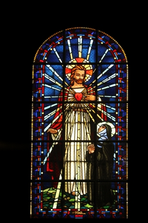 Sacred heart of Jesus and Saint Margaret Mary Alacoque, stained glass, Notre Dame de Clignancourt church, Paris, France
