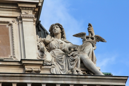 headquartered: Statue of commerce on the BNP building in Paris on Nov 11, 2012 in Paris  BNP Paribas S A  is a French global banking group, headquartered in Paris  Editorial