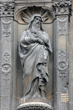 Statue at the south portal of the church of St  Eustache, Paris photo