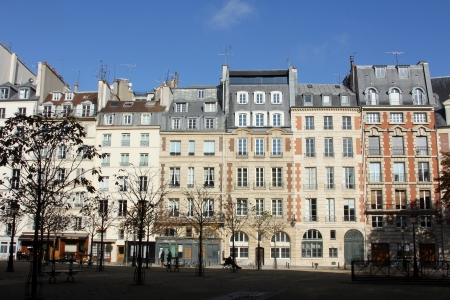Facade of a traditional apartmemt building in Paris, France