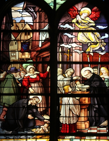 Saint Vincent de Paul raising a newborn and christening, stained glass, Saint Severin church, Paris, France