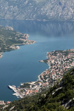 Panorama  Site bay of Kotor with high mountains plunge into adriatic sea and Historic town of Kotor, Montenegro photo