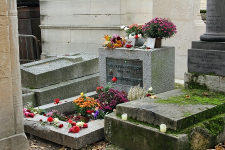 jim: PARIS - NOVEMBER 07:Jim Morrison grave in P�re Lachaise cemetery, Paris. Each year thousands fans and curious visitors come to pay homage to Jim Morrison