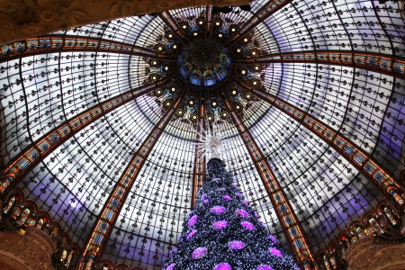 christmas perfume: The Christmas tree at Galleries Lafayette, trade pavilions with perfume, November 11, 2012, Paris, France.