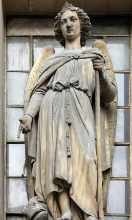protection of the bible: Archangel Raphael, Madeleine church in Paris Stock Photo