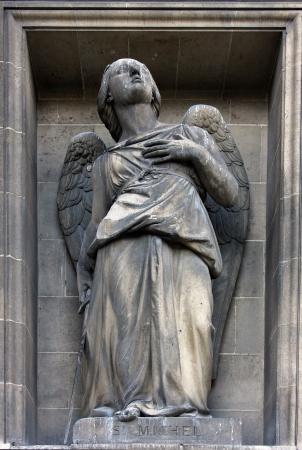 Archangel Michael, Madeleine church in Paris photo