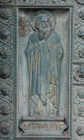 Saint Bartholomew, detail of door of Saint Vincent de Paul church, Paris photo
