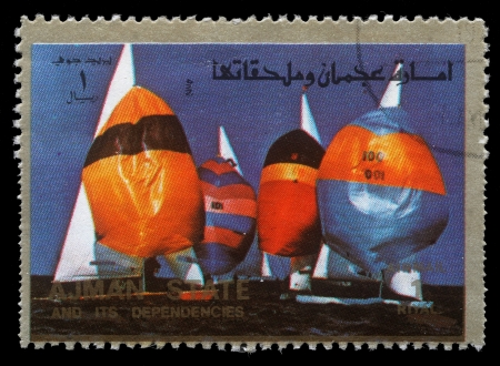 summer olympics: AJMAN - CIRCA 1973  a stamp printed in the Ajman shows Sailing, Summer Olympics, circa 1973