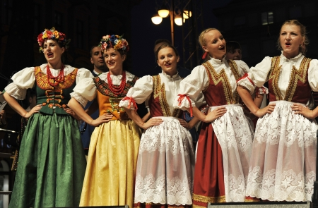 ZAGREB,CROATIA - JULY 18: Members of the ensemble song and dance Warsaw School of Economics in Polish national costume during the 47th International Folklore Festival in center of Zagreb,Croatia on July 18,2013