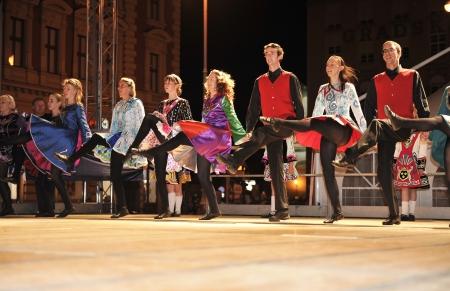 ZAGREB,CROATIA - JULY 18  Members of folk groups O Shea-Ryan Irish Dancers from Australia during the 47th International Folklore Festival in center of Zagreb,Croatia on July 18,2013