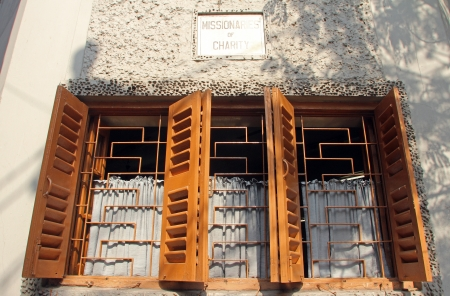 Windows of the Mother House, where Mother Teresa used to live on Nov 25, 2012 in Kolkata, West Bengal, India