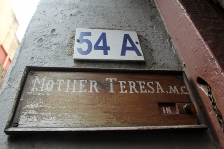 Sign on the entrance to Mother House, the residence of Mother Teresa in Kolkata, West Bengal, India on Nov 25,2012