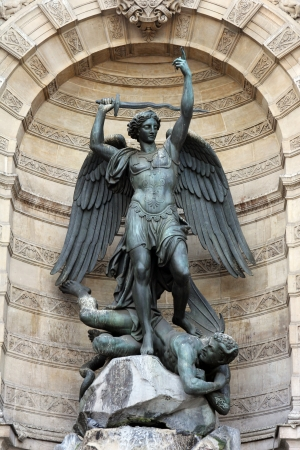 Fountain Saint-Michel at Place Saint-Michel in Paris, France It was constructed in 1858-1860 during French Second Empire by architect Gabriel Davioud Archangel Michael and devil by Francisque Duret
