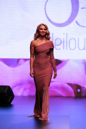 Fashion model wears dress made by Leitou on  Wedding days  show, October 04, 2013 in Zagreb, Croatia