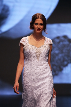 Fashion model wears dress made by Nancy on  Wedding days  show, October 04, 2013 in Zagreb, Croatia  Editorial