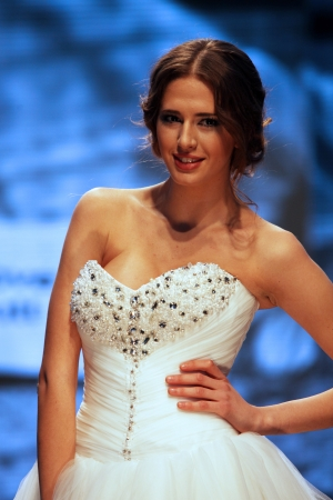 Fashion model wears dress made by Kontesa Nera on  Wedding days  show, October 04, 2013 in Zagreb, Croatia