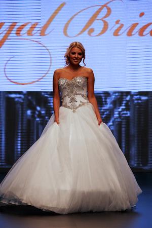 wears: Fashion model wears dress made by Royal Bride on Wedding days show, October 04, 2013 in Zagreb, Croatia.