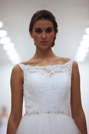 Fashion model in wedding dress made by Lisa and Maggie Sottero on  Wedding Expo  show in the Westgate Shopping City in Zagreb, Croatia on October 12, 2013