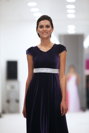 Fashion model in cocktail dress made by Miss B on  Wedding Expo  show in the Westgate Shopping City in Zagreb, Croatia on October 12, 2013