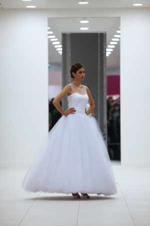 Fashion model in wedding dress made by Hera  Wedding Expo  show in the Westgate Shopping City in Zagreb, Croatia on October 12, 2013