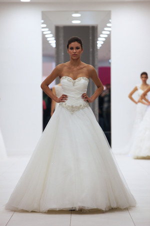Fashion model in wedding dress on  Wedding Expo  show in the Westgate Shopping City in Zagreb, Croatia on October 12, 2013