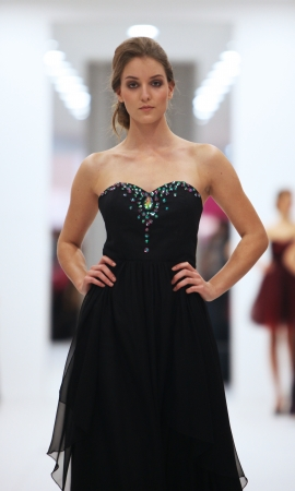 Fashion model in cocktail dress made by Ana Milani on  Wedding Expo  show in the Westgate Shopping City in Zagreb, Croatia on October 12, 2013 Editorial